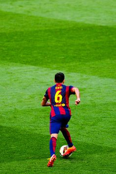 Xavi Hernandez of FC Barcelona runs with the ball during the La Liga match between FC Barcelona and RC Deportivo de la Coruna at Camp Nou on May 23, 2015 in Barcelona, Catalonia.