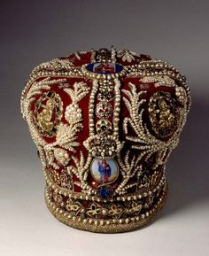 One of the Romanov crowns, with gold embroidery, pearls and diamonds on red velvet.