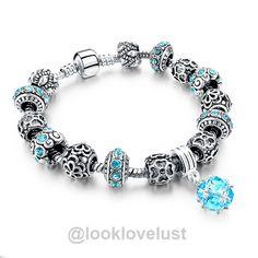 Tibetan Silver Blue Crystal Charm Bracelets  -  Bracelets  -  Look Love Lust  https://www.looklovelust.com/products/tibetan-silver-blue-crystal-charm-bracelets