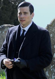 Rob Thomas-Collier aka Thomas, of Downton Abbey.enjoying of all things.a CURLY WURLY! one of my favs! Legion Fox, Rob James Collier, Rob Thomas, Downton Abbey, Good Looking Men, Moving Forward, Female Characters, Hot Guys, Curly Wurly