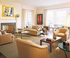 Mariette Himes Gomez designed the interiors of a Robert A.M Stern-built house in Southampton, New York. In the living room are Roy Lichtenstein's Reflections: Spray II, left, and Thin Edge by Ralph Humphrey. (March 2005)
