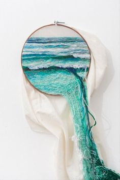 Embroidery of waves in  the ocean with excess thread acting as extra water. Awesome!