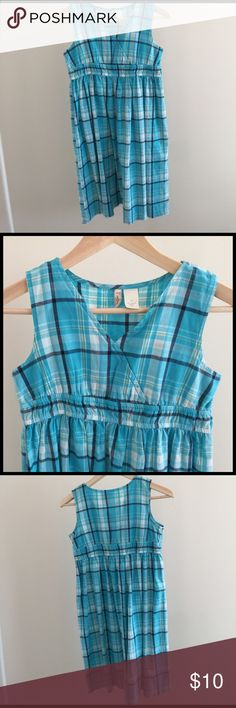 Sundress girls or small woman NWOT. Blue plaid. Cross over front creates empire waist. Elastic fabric stretches for waist. It's an 18 girls, but it fits me perfectly. I don't really care how clothes fit, but TH usually has the most consistent sizes and I'm a 2 there. Red Camel Dresses Mini
