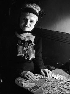 Tarot card reader and occultist, Madame Arthur, Paris, 1951  by Robert Doisneau