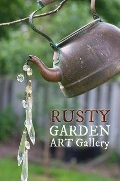 Rusty garden art ideas including orbs, bee skep, kettle, old tool creatures at empressofdirt.net