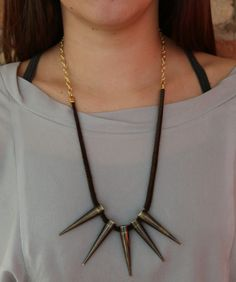 """Crown Release Designs // 5 Spike Leather Necklace // 5 Spikes hang on leather cord with a gold chain finish. Necklace length measures 20"""""""
