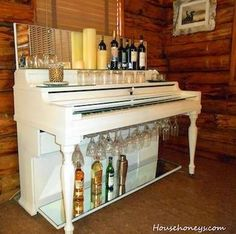 A Real Piano Bar  A coat of fresh paint and mirrors add panache to this recycled piano cocktail bar. Display wine bottles or candles up top and outfit the underside of the keyboard with wineglass holders. A glass shelf over the keys provides even more storage, as well as a handy place to rest drinks.