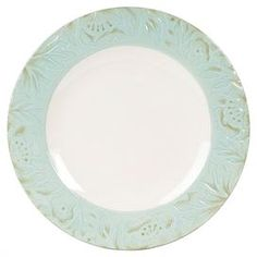 """Stoneware dinner plate with a textured floral border.  Product: Dinner plateConstruction Material: StonewareColor: GreenDimensions: 11"""" Diameter"""