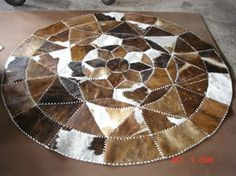 Patchwork cow skin  rugs, leather carpets, pillows and home interior decor Merco rustic rugs