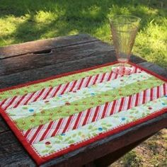 christmas quilt patterns | Holly Jolly Quilted Placemat | FaveQuilts.com