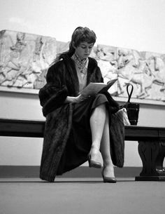 """steroge: """" Brigitte Bardot reading a leaflet while visiting the British Museum in London, 1955 (Popperfoto/Getty Images) """""""