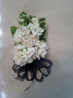 Pin on corsage of all white stock blossoms Wedding Corsages, Mom And Grandma, All White, Blossoms, Floral Wreath, Wedding Ideas, Wreaths, Design, Flowers