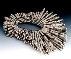 innovative paper jewelry  - by Holly Anne Mitchell |   http://www.newspaperjewelry.com/abouttheartist.html