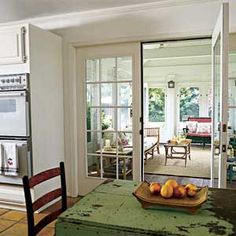 french doors leading from kitchen into three season porch
