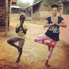 A Peace Corps Volunteer in Ghana is joined by a boy from her village for a little yoga.