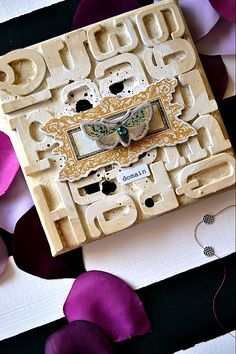 LOVE!!! SHe used chipboard letters to make this!