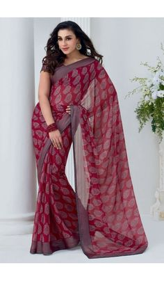 Grace yourself by draping in this Maroon #chiffon #brasso printed #casual wear #saree with trendy and #elegant print on it. The saree is an ideal choice of attire for casual events and comes attached with matching blouse piece that can be custom made for upto bust size of 42 inches.