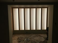 LED back lit wall modern and funky , this one will have wine racked I front of it