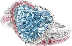 A 3.04-carat, heart-shaped fancy intense blue diamond set in a ring surrounded by pink diamonds sold for $2,158,974.  oh yea