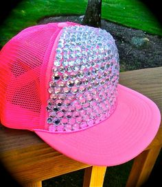 It's a hot pink trucker hat AND it's covered in sequins or rhinestones? My life won't be complete w/o it