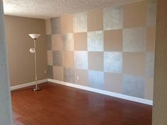 My rental unit. Squares painted on the wall in silver metallic paint.  Wood floor, silver, beige, modern wall treatment, squares, Square, wood, medium brown, do-it-yourself