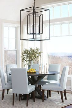 Light Blue Dining Room Chairs Round Table Large Windows Pendant Lighting