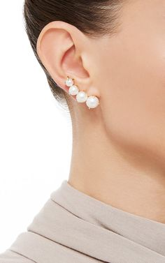 These earrings by Ana Khouri are rendered in yellow gold featuring four  Australian pearls along a 059e61f3c6e7c