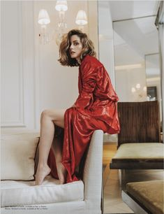 Olivia Palermo poses in a red Michael Lo Sordo blouse and skirt