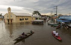 A view of a street flooded by the rising Rio Solimoes, one of the two main branches of the Amazon River, in Anama, Amazonas state, Brazil May 28, 2015. According to the state Civil Defense, more than 237,615 people were affected in the State with strong rains. Picture taken on May 28, 2015. REUTERS/Bruno Kelly
