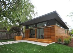 Considering this siding for our house some day! Nice Shades: Michelle Kaufmann's Latest Prefab Has Overhangs, Brise Soleil and Shutters : TreeHugger