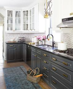 Kitchen. Wrought Iron paint on bottom and White Cloud paint on top cabinets, both by Benjamin Moore.