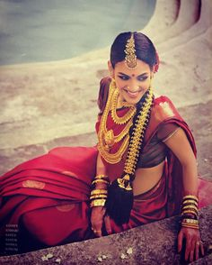 South Indian bride. Gold Indian bridal jewelry.Temple jewelry. Jhumkis. Red silk kanchipuram sari.Braid with fresh jasmine flowers. Tamil bride. Telugu bride. Kannada bride. Hindu bride. Malayalee bride.Kerala bride.South Indian wedding. Rukmini Vijayakumar.