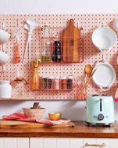 Looking at a new home with limited kitchen storage? This DIY pegboard wall will put everything in its place. #sponsored #getrealtor