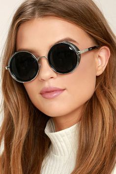 "These ""Perverse Madness Black and Silver Round Sunglasses"" are so cool they're driving us mad! Built-in side shields (with vegan leather accents) give these round sunglasses a steampunk style that's totally trendy! UV 400."