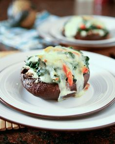 Spinach And Ricotta Stuffed Portobello Mushrooms-use low fat version of cheeses.  Add artichokes.