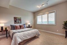 One of 5 bedrooms with a walk-in closet and ensuite bathroom.