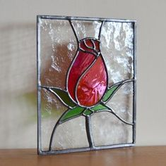 A red rosebud - traditional symbol of Love. Designed and made by Radiance Stained Glass. Stained Glass Ornaments, Stained Glass Flowers, Faux Stained Glass, Stained Glass Designs, Stained Glass Panels, Stained Glass Projects, Stained Glass Patterns, Pebeo Vitrail, Glass Wall Art