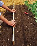 Seeding tool, both for depth and spacing of seeds.  Could mark with legend for most common seeds planted.  Could even include usual planting dates.