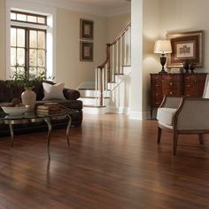 Love the rich wood look of this Sherwood Oak laminate floor. With floor this durable and stylish in your living room, you don't even need a rug! #LF000658
