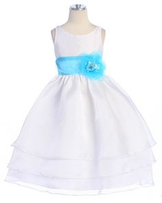 White Organza Dress: This elegant white organza flower girl dress features a sensational sleeveless style with a triple layer skirt. This beautifully simple white organza tea length dress comes with a adjustable sash tie in the back. Like many of our special occasion dresses, it is versatile and can be used as a flower girl dress, pageant dress, or even as a first communion dress. No matter the occasion, this will make your little flower girl even more adorable and irresistibly adorable.