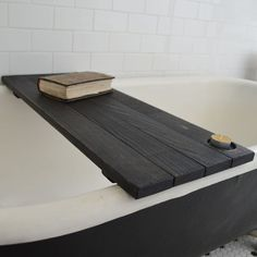 Ebonized Reclaimed Wood Tub Caddy by PegandAwl on Etsy -  love design idea for a platform to put candles and flowers on...down the center of the table.  Smaller scale and without hole.