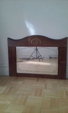 Used (normal wear) - Sea shell inspired decorative mirror.  In good condition.  ** The mirror seens a tad bit loose in one area. Maybe you can fix it. See pictures. ** Some warping of the wood like materials. See pictures Made of wood and wood like matetials.  This mirror is heavy.  Measurements- Length- 31.5 inches, height- 22 inches. Mirror measurement- 23 inches x 15 inches
