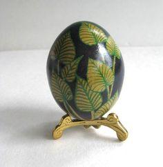 Pysanka, batik egg on chicken egg shell, Ukrainian Easter egg with leafs design