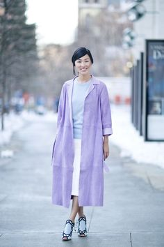 Pin for Later: Flashback Friday: NYFW Street Style Stars Trekked Through the Snow For Fashion NYFW Street Style Day 6 Nicole Warne's artfully applied pastels — and gorgeous heels — were meant to be shown off at Fashion Week.  Source: Tim Regas