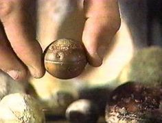 The Grooved Spheres. Miners in South Africa have been digging up mysterious metal spheres. Origin unknown, these spheres measure an inch or so in diameter, and some are etched with three parallel grooves running around the equator. Two types of spheres have been found: one is composed of a solid bluish metal with flecks of white; the other is hollowed out and filled with a spongy white substance. The rock in which they where found is Precambrian - and dated to 2.8 billion years old!