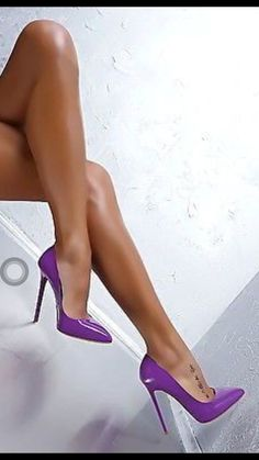 glowing tan, provocative crossed  legs, a little foot tattoo, and neon purple heels... so much style, oh my, WOW!! :)