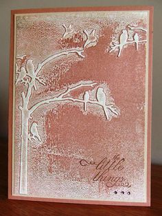 """Swipe the """"positive"""" side of the embossing folder with an ink pad, carefully lay your card on it, then run it through the Cuttlebug.  Beautiful!"""