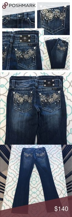 """💙👖Gorgeous Miss MeJeans👖💙29 7/8 31"""" Floral 🌺 💙👖Gorgeous Miss Me Jeans👖💙 Pretty Floral 🌺 Design! So Pretty! Bling! Studs! Size 29 (7/8). 30.75"""" Inseam. 8.25"""" Rise 14.75"""" Across Back. Awesome Stretch. Dark Blue Wash. Bright Fading. Light Distressing. Boot Cut. Very Very Light Fray. Very Good Used Condition. Adorable! Miss Me! LOVE! The Buckle! Ask me any questions! : ) Miss Me Jeans Boot Cut"""