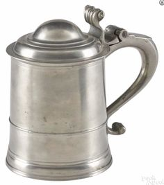 Pook & Pook 1/15/16 Lot: 162.  Estimated: $3,000 - $5,000.  Realized Price: $7,380.  Description: Boston IC type pewter tankard, 18th c., 6 3/4'' h. Provenance: The Collection of Jeanne and Bernard B. Hillmann, Wyckoff, New Jersey.  Condition: Good condition. No apparent damages or repairs.