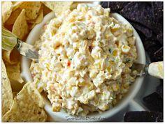 FIESTA CORN SALSA -  {Fiesta corn, mayo, sour cream, cheddr cheese, green onion, cilantro, cumin, cayenne pepper...}  Serve with your favorite tortilla chips or Fritos.